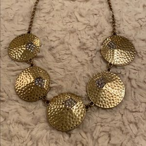 Gold tone necklace with hammered circles